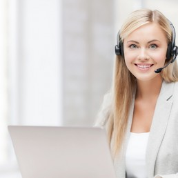 woman wearing a headset at a computer